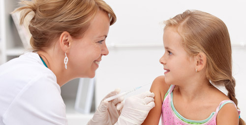 A small child getting an injection